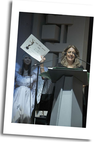 US Director Delara Rasouli demonstrates her 'Best Art Film Award' for 'Al Nessa' verses from the Holy Quran